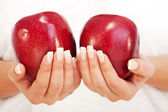 Young woman holding red apples — Stock Photo