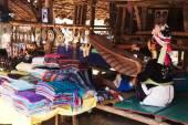 Long neck woman weaving — Stock Photo
