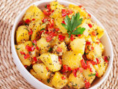 Potatos with sesame and cilantro — Stock Photo