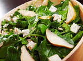 Fresh spinach salad with cheese — Stock Photo