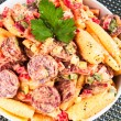 Pasta with sausage and tomato — Stock Photo #63380641
