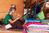 Long neck woman weaving — Stock Photo