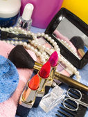 Cosmetics with lipsticks and pearl — Stock Photo