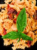 Fusilli with salmon and dried pepper — Stock Photo