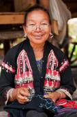 Old Thai woman with large earings — Stock Photo
