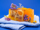 Soaps with Flowers on blue — Stock Photo