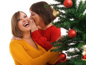 Women and christmas tree — Stock Photo