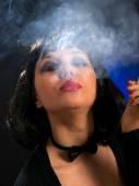 Cat-woman smoking cigarette — Stock Photo