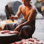 Burmese man cooking meat — Stock Photo #63749633