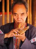 Senior Thai man performing music — Stock Photo