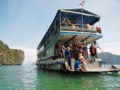 Small tour ship with people — Stock Photo