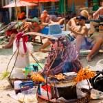 Thai woman selling chicken skewers — Stock Photo #63760999