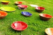 Colored clay plates at the fair of artisans in Riga — Stock Photo