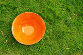 Orange  clay pottery plate at the fair of artisans in Riga — Stock Photo