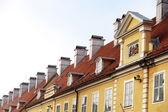 Chimneys and red-tiled roofs of  building in Old Riga — Stock Photo