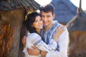 Romantic young couple in Ukrainian style clothes outdoors — Stock Photo