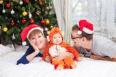 Young family with baby boy dressed in fox costume — Foto de Stock