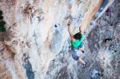 Rock climber holding on handhold while climbing cliff — Stock Photo