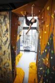 Man practicing top rope climbing in climbing gym — Stock Photo