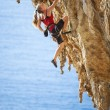Female rock climber on a cliff — Stock Photo #73254931