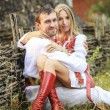 Young couple in Ukrainian national clothes — Stock Photo #73515927