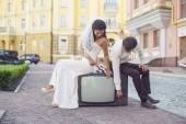 Newlyweds sitting on retro tv set — Stock Photo