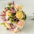 Bridal bouquet of roses and alstroemeria isolated on white — Stock Photo #71973483