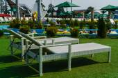 Empty sunbeds at the aquapark, focus on foreground — Stock Photo