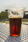 Glass of beer backlit afternoon sun close-up — Stock Photo