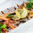 Fish plate with assorted salted fish with lime and parsley. — Stock Photo #54876191