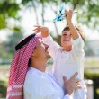 Arabic father and little kid play outdoors — Stock Photo #65580783