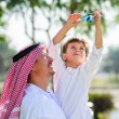Arabic father and little kid play outdoors — Stock Photo #65580785