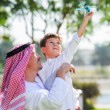 Arabic father and son. — Stock Photo #65580787