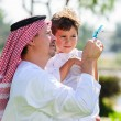 Arabic father and son. — Stock Photo #65580839