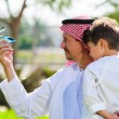 Arabic father and son. — Stock Photo #65580841