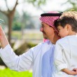 Arabic father and son. — Stock Photo #65580845