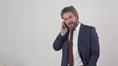 Man in suit with tie talking on a mobile phone — Stock Video