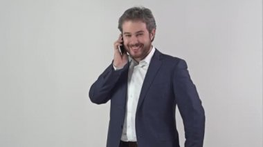 Man in suit talking on a mobile phone full video — Stock Video