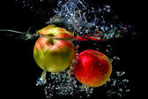 Apples falling to the water — Stock Photo