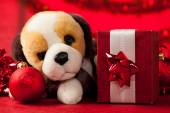 Toy dog with christmas ornaments — Stock Photo