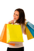 Preety young woman with colorful shopping bags isolated over whi — Stock Photo