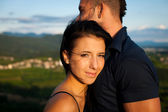 Teenage couple on a late summer afternoon in park — Stock Photo