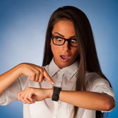 Stressed woman staring into watch gesturing being late — Stok fotoğraf