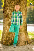 Boy resting under tree in late summer afternoon — Stock Photo