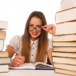 Happy asian caucasian girl lerning in study woth lots of books o — Stock Photo #57114119
