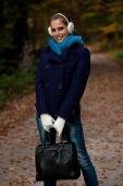 Blog style pretty young woman on a walk in forest on late autumn — Stock Photo