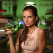 Pretty young brunette woman drinking cocktail in bar — Stock Photo #58755557