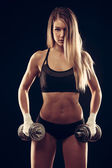 Attractive young woman working out with dumbbells - bikini fitne — Stock Photo