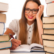 Happy asian caucasian girl lerning in study woth lots of books o — Stock Photo #59965233