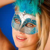 Cute blonde woman with venice mask on her face glamorous portrai — Stock Photo